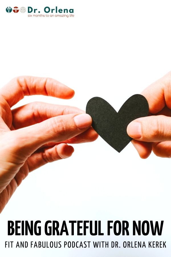 A photo of a person giving another person a heart cutout #gratitude #grateful #mindset #healthy #wellness #healthyliving #healthylife
