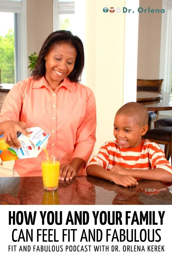 A mother pouring her son orange juice inside the kitchen #healthy #family #healthyfamily #happyfamily #healthylifestyle #healthylife