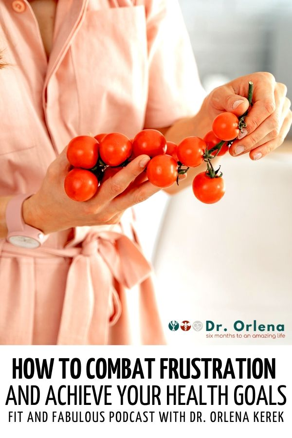 A woman holding a stem of tomatoes #health #healthgoals #healthy #wellness #healthyliving #healthylife