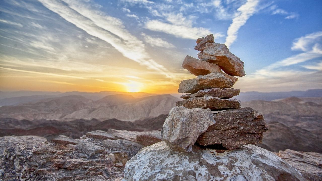 stacked stones on mountain top