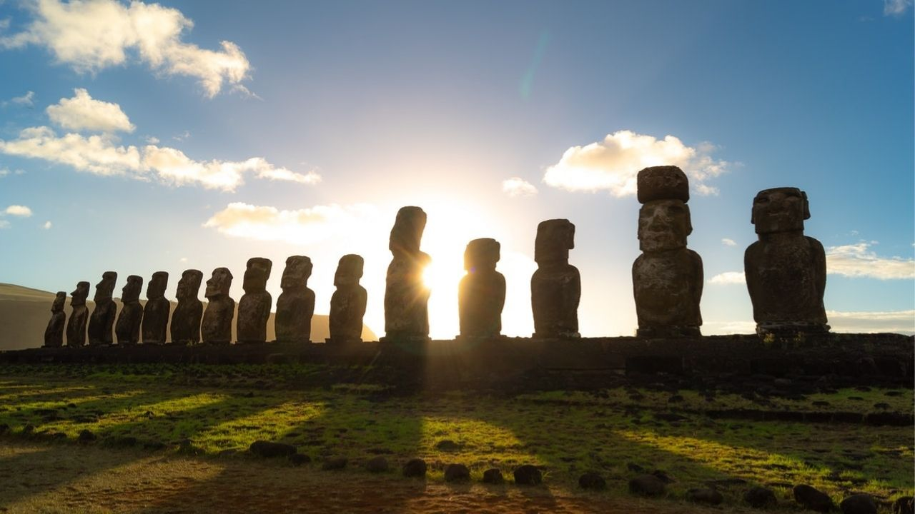 several large stone statues in a row