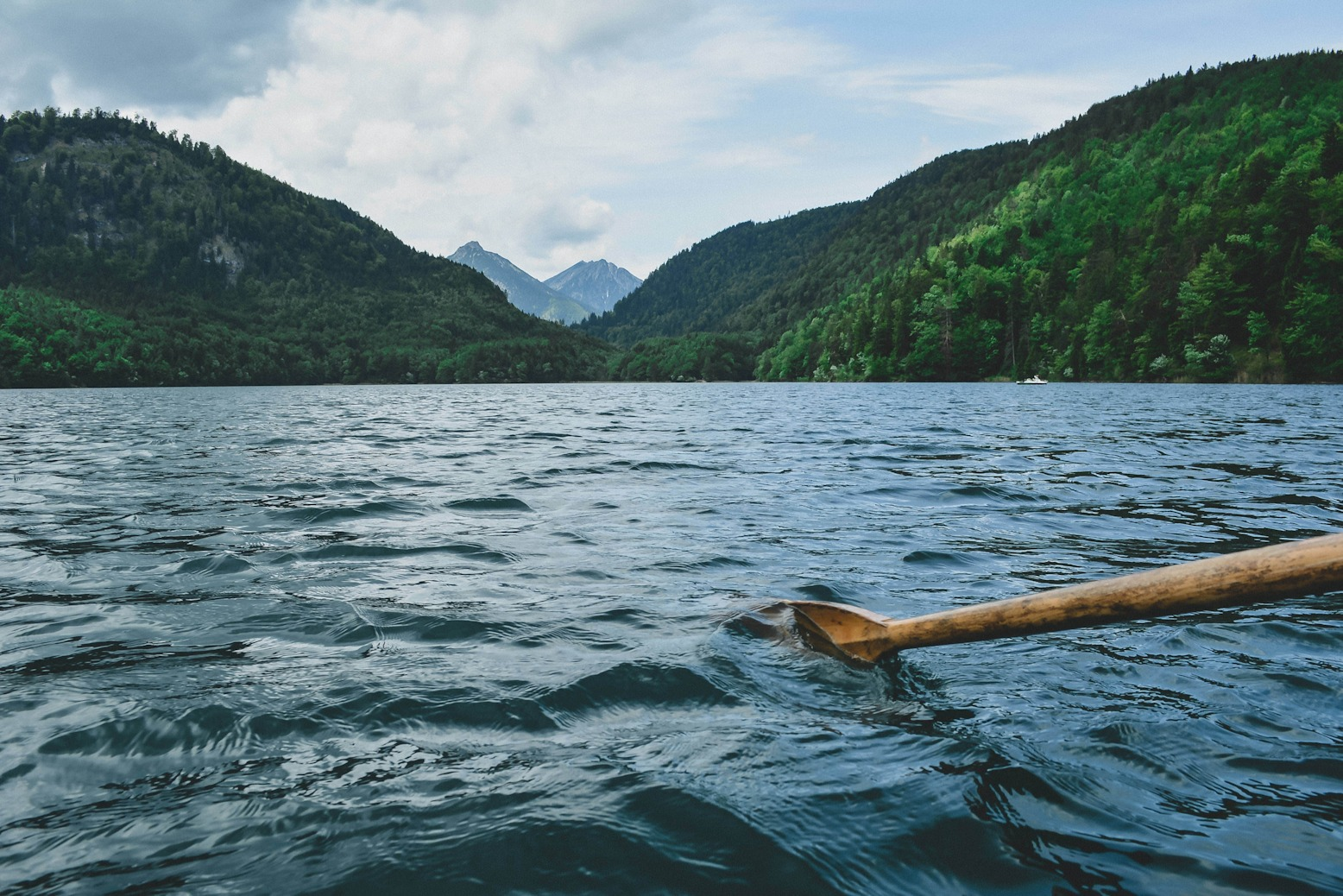 one oar rowing in a peaceful lake