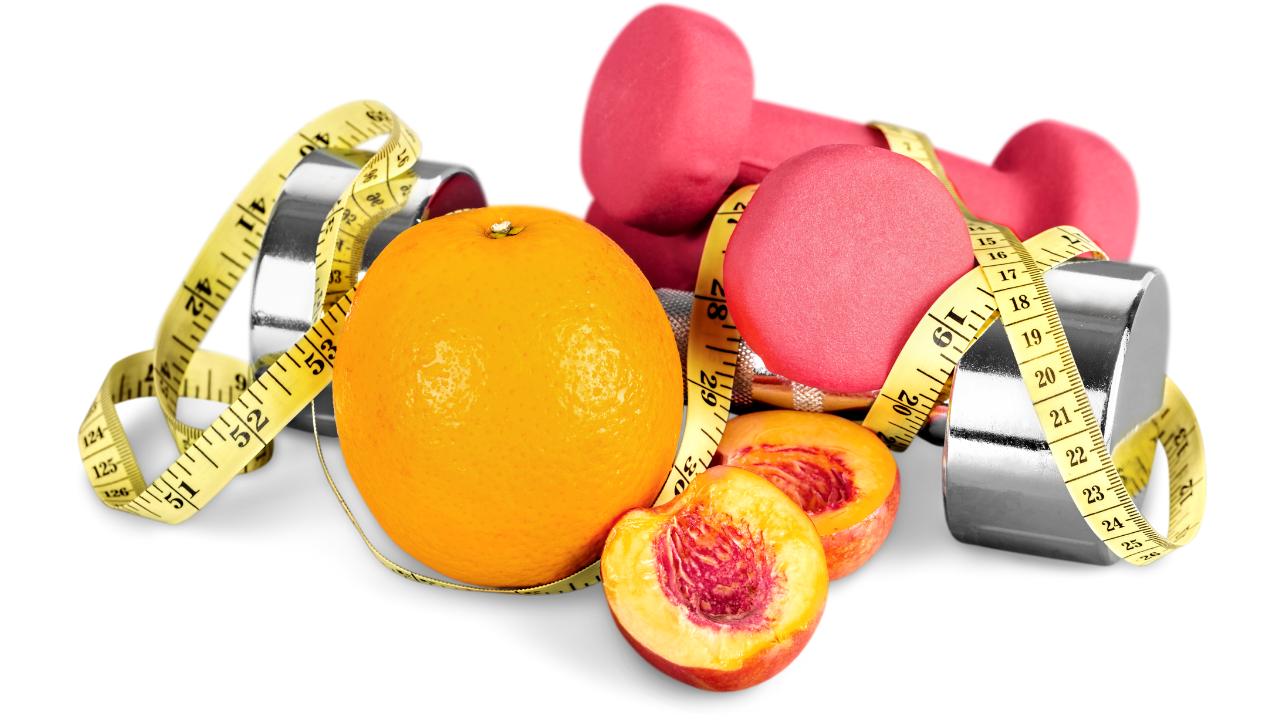 Weights, fruit, measuring tape