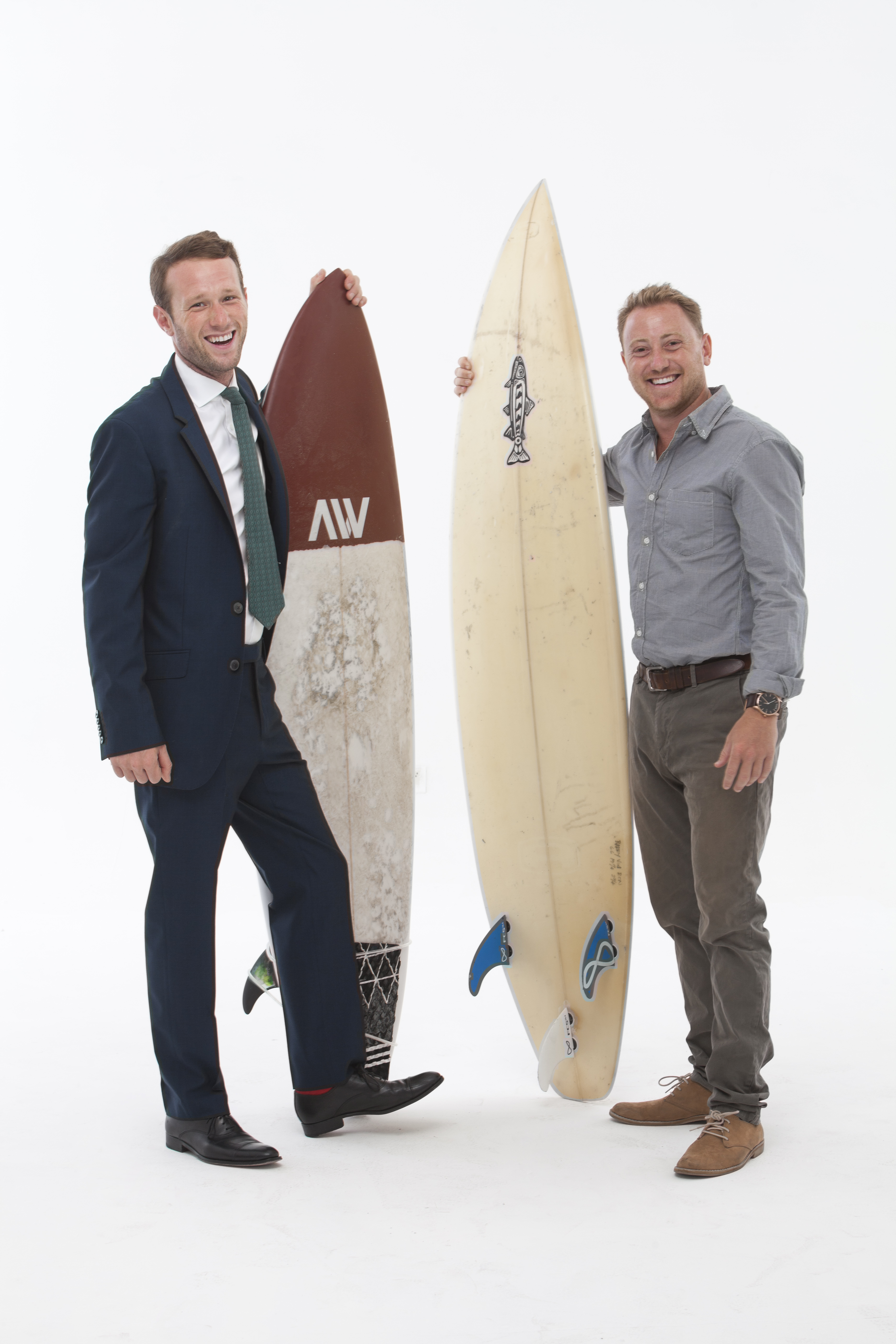 Ed Hutchinson and David Johnstone posing for a photo with their surfboards