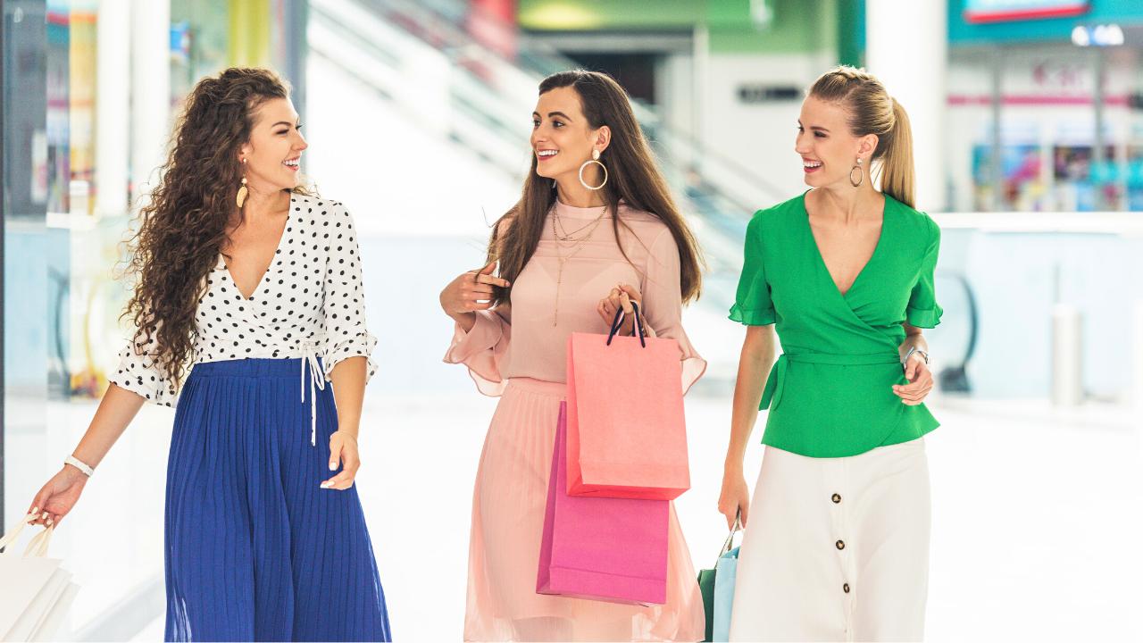 3 women shopping in mall