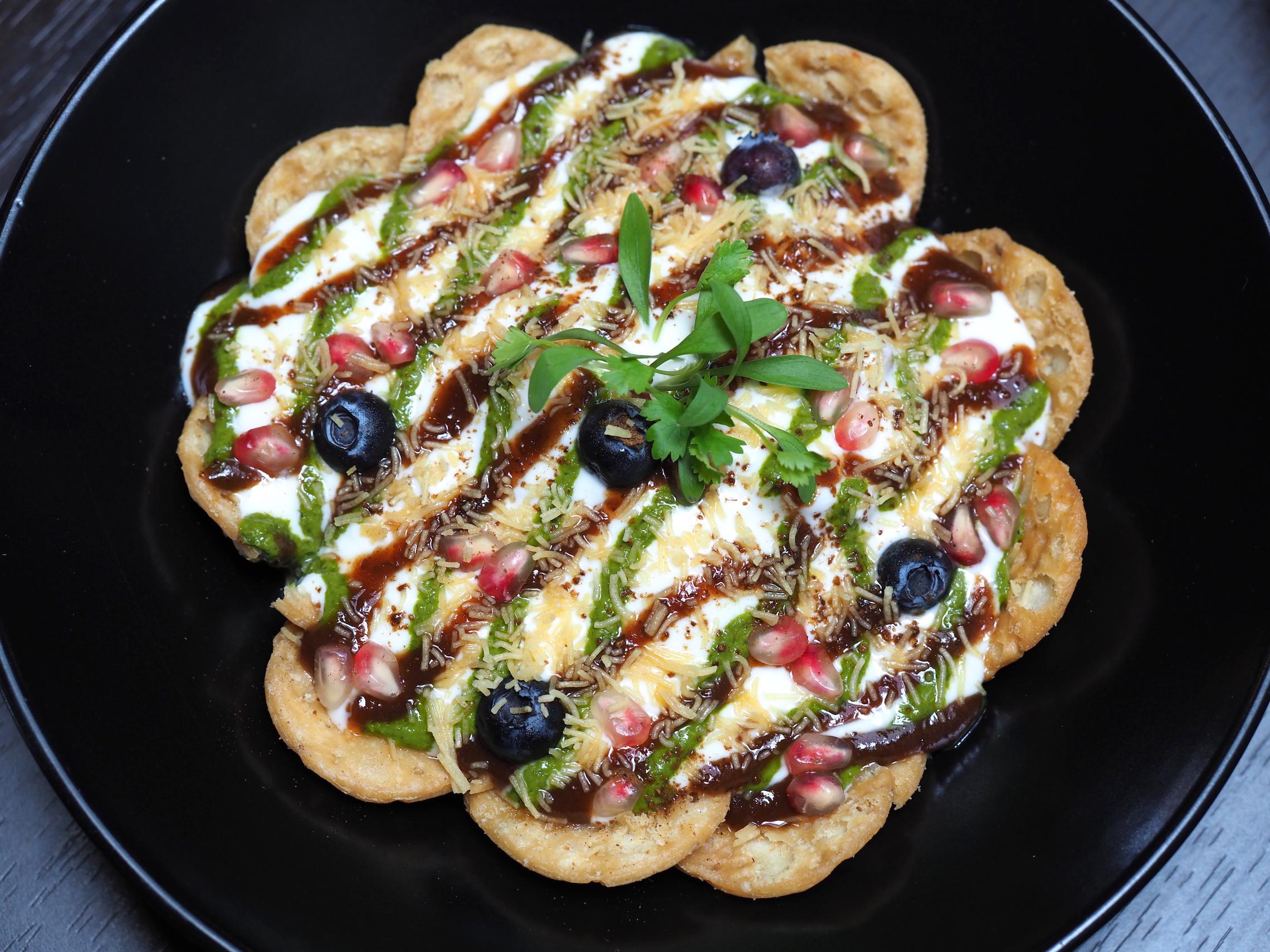 tamarind chutney, imli ki chatni and mint chutney drizzled over fruit salad