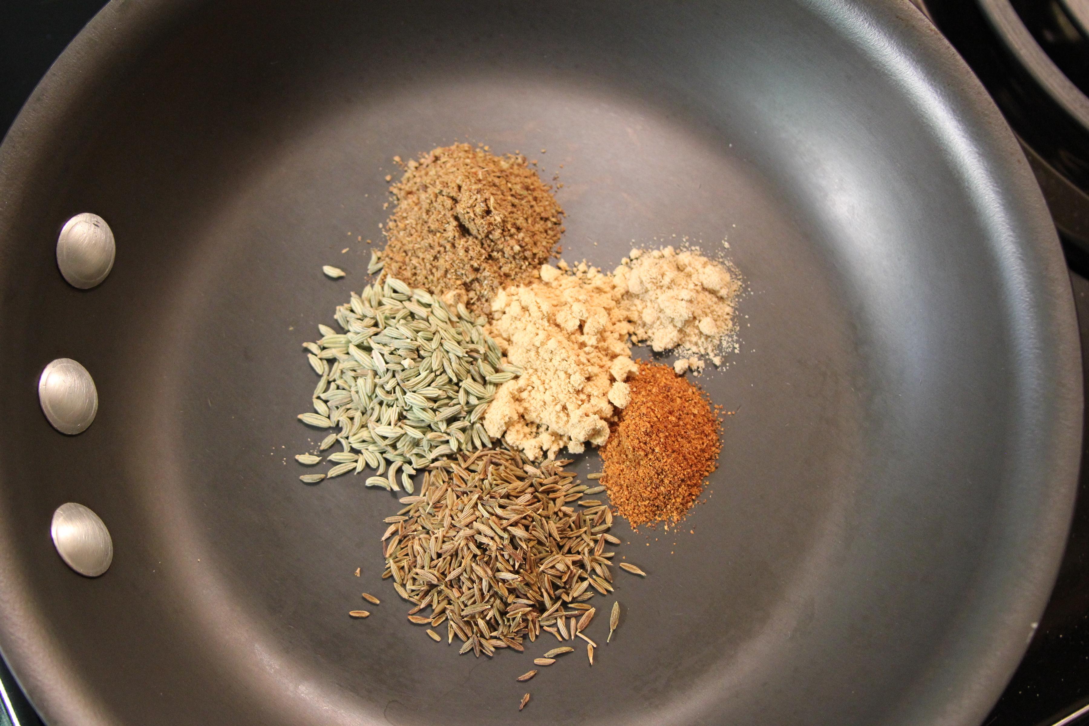 tamarind chutney, imli ki chatni spices in a pan fennel, cumin, ginger, chili powder and garam masala