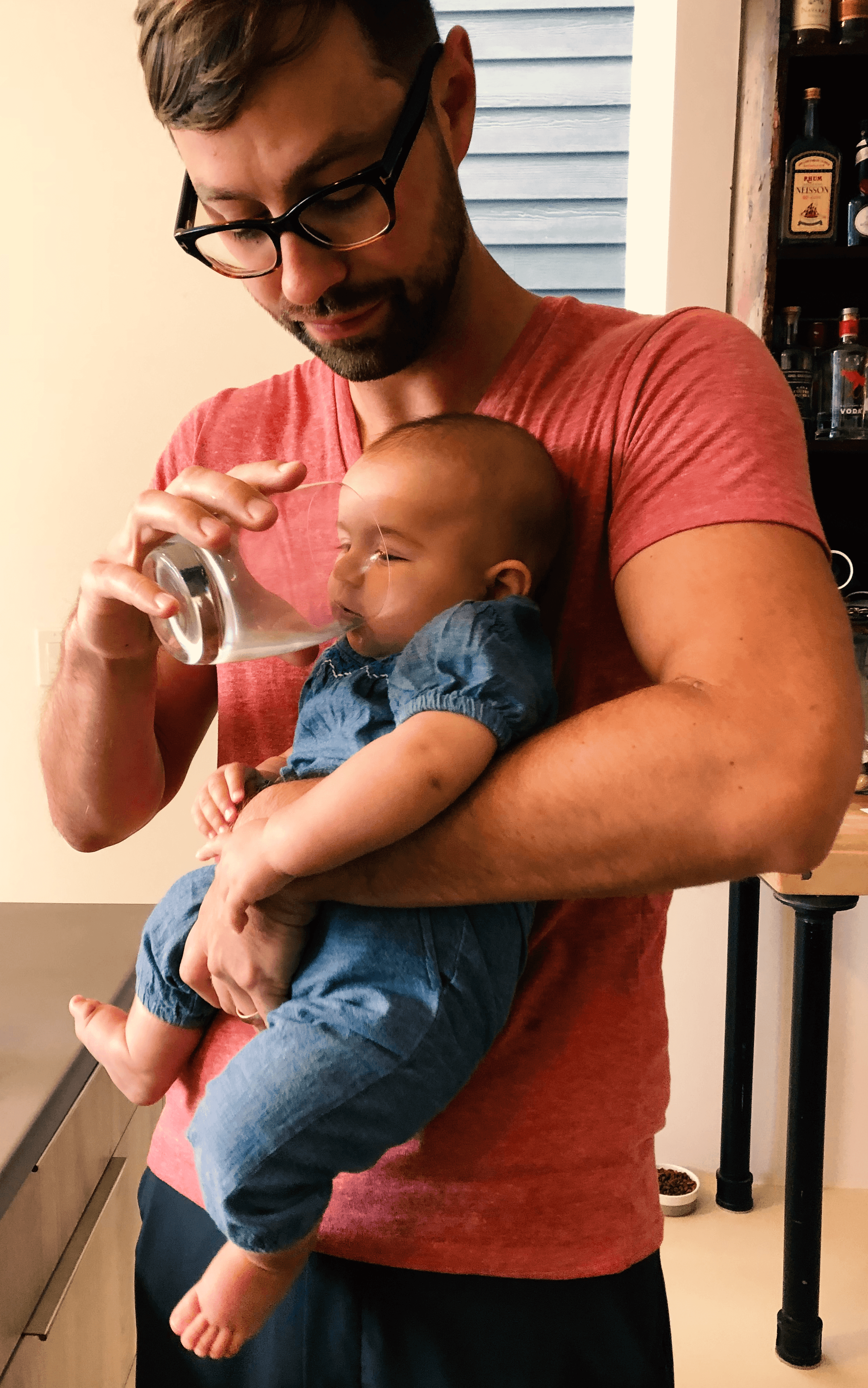 dad giving water to his child