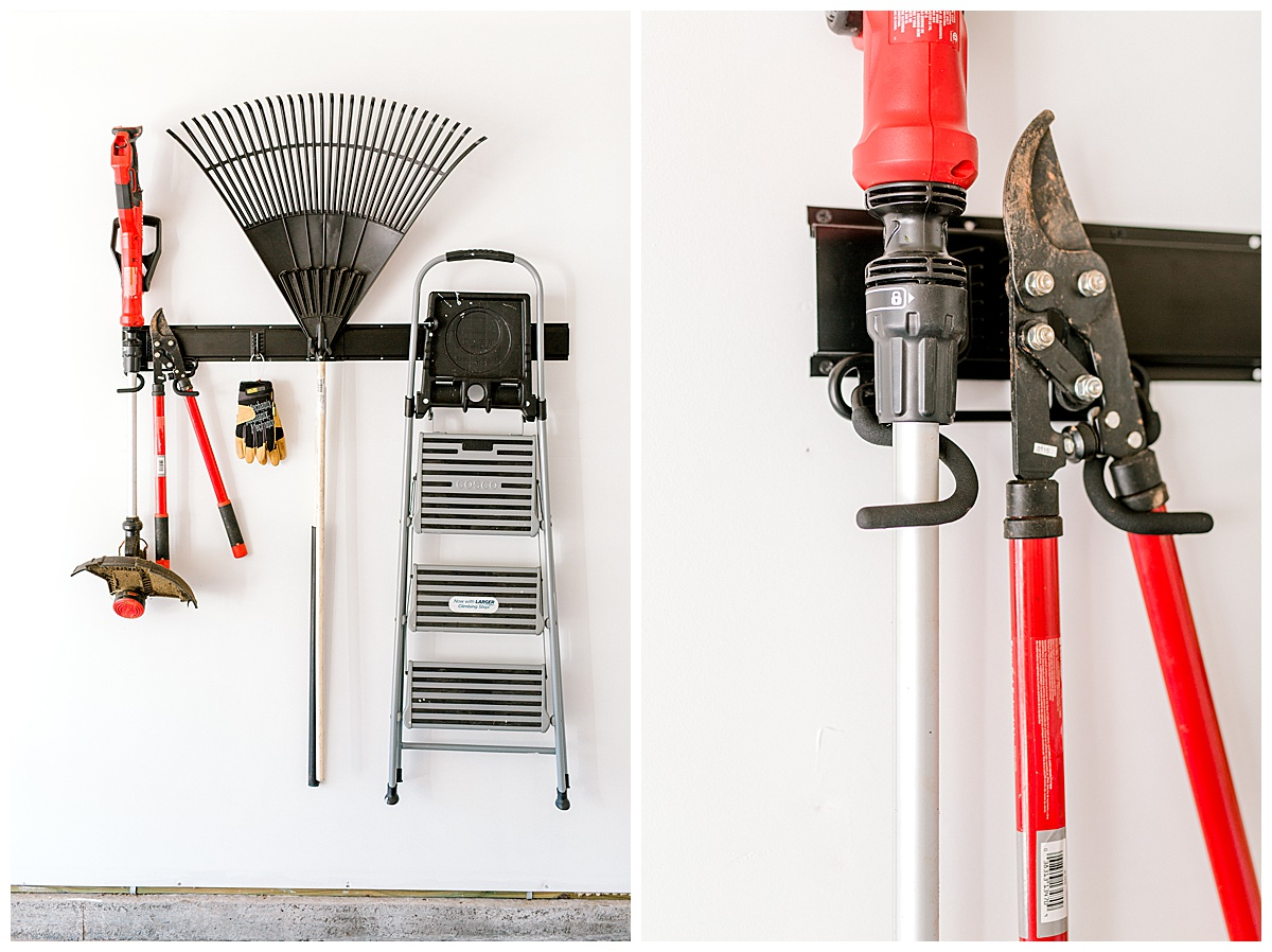 Wall mounted organizing system filled with rakes, shovels and a ladder.