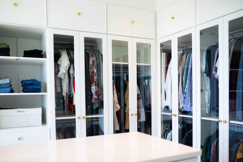 Large, organized closet with built-in shelving.