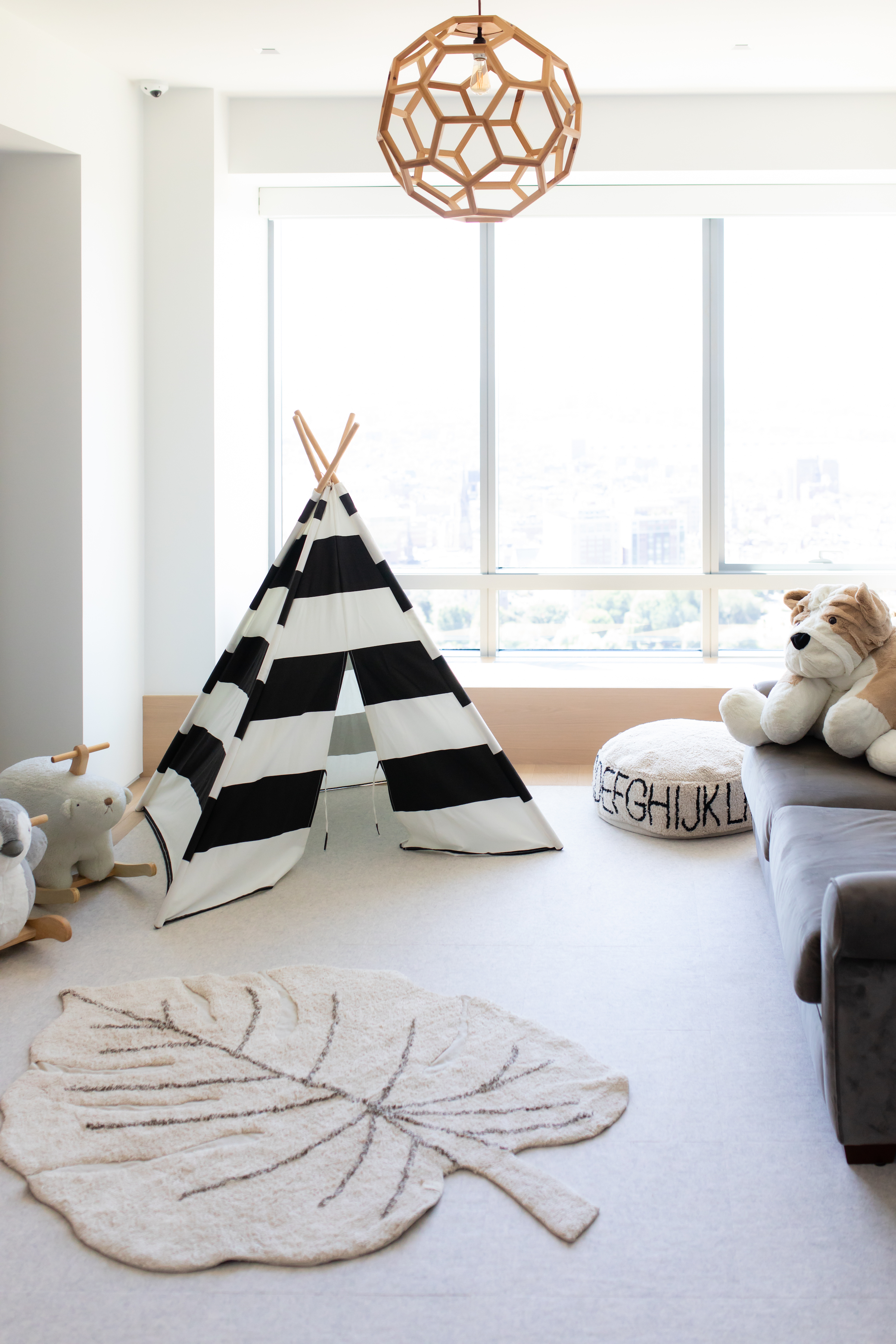 Organized kids' room with neutral decorations.