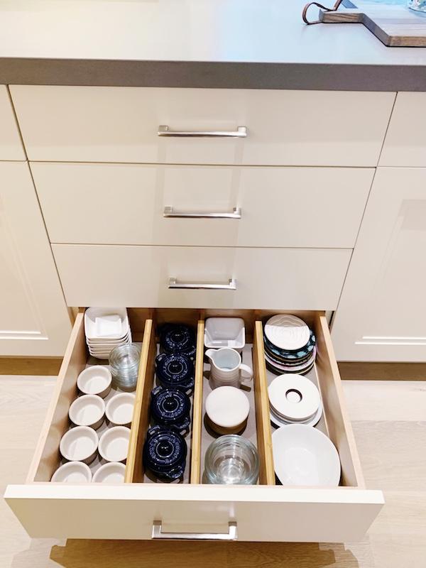 Organized kitchen drawer with Tupperware.