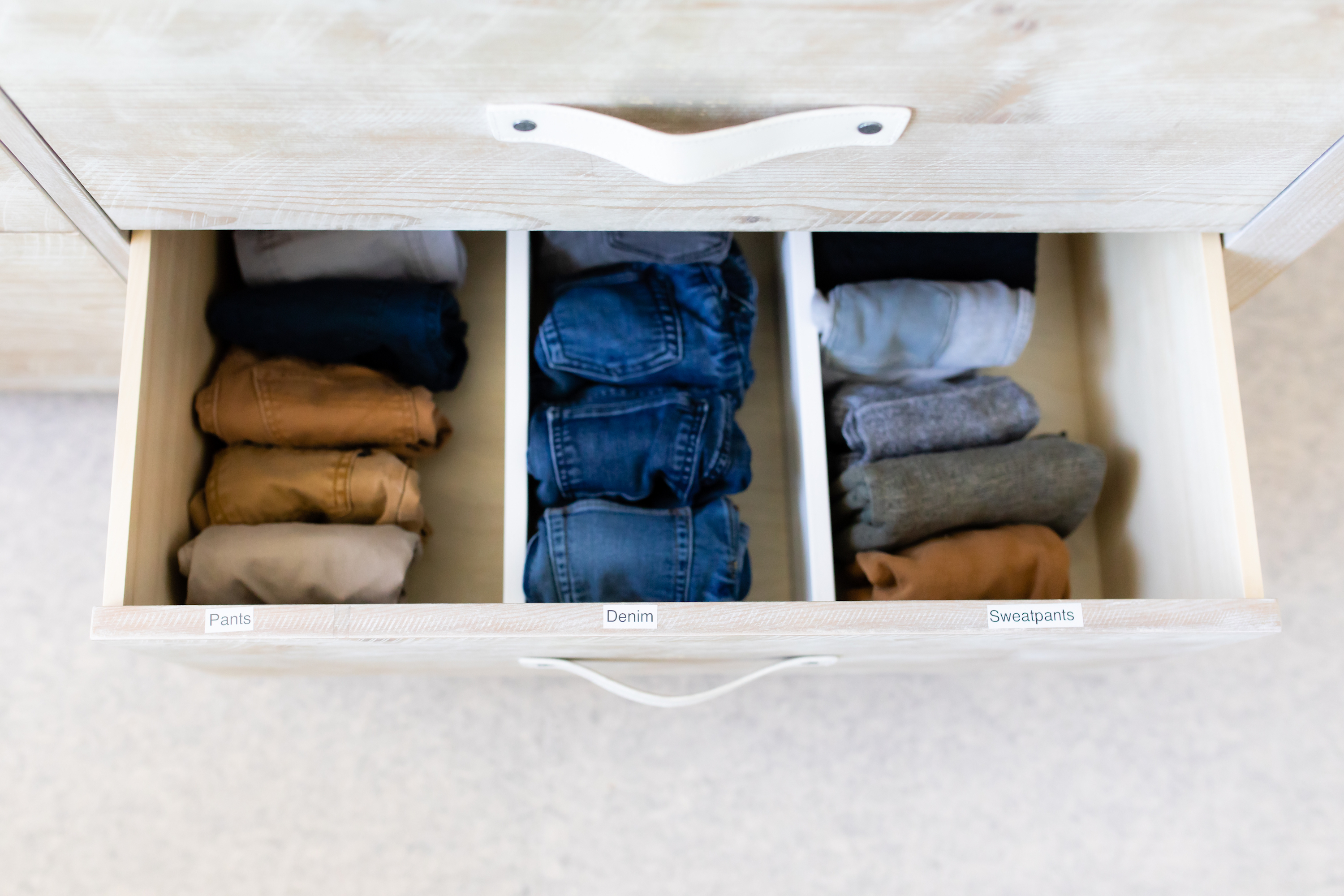 Bedroom drawers organized by color.