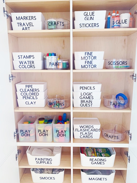 Closet full of school supplies including stamps, markers and colored pencils.
