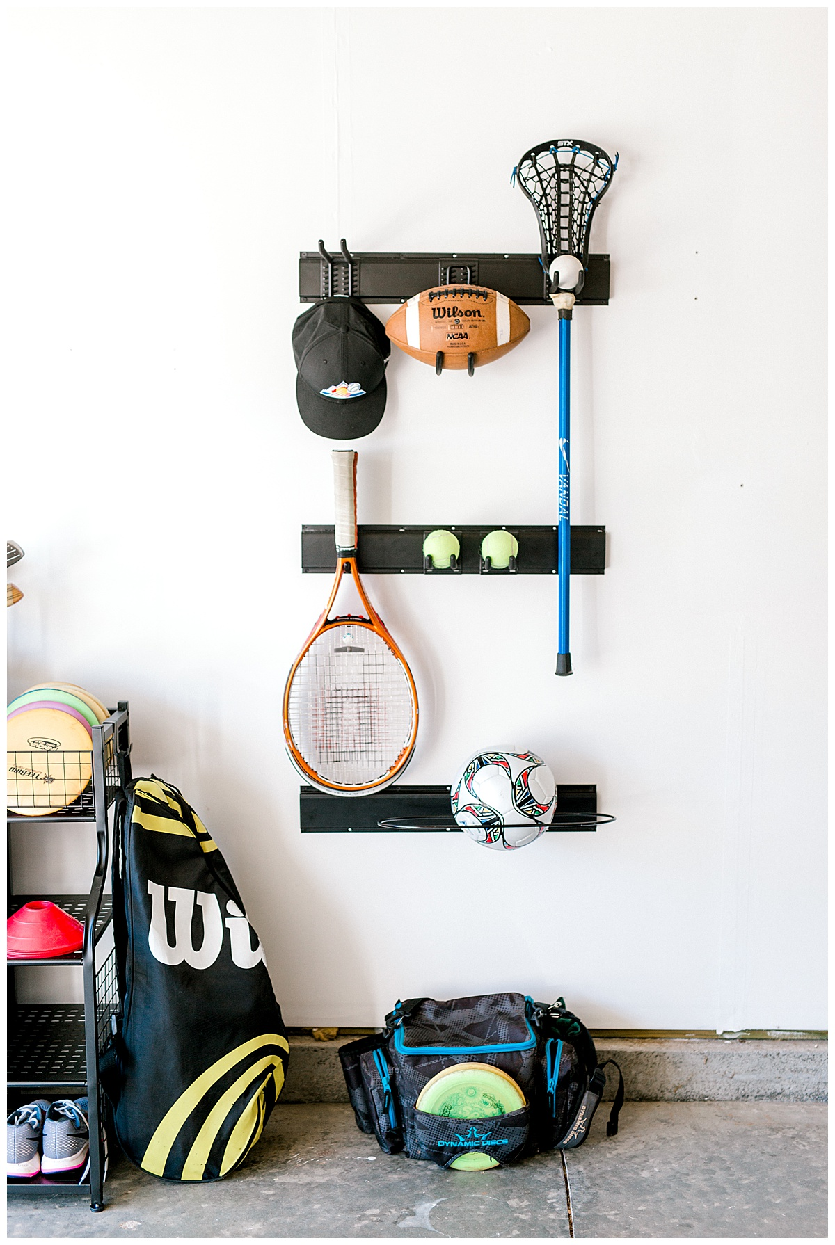 Wall storage system in a garage for sporting equipment.