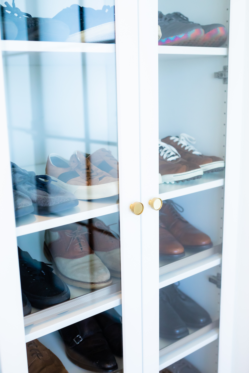 Cabinet with neatly organized shoes.
