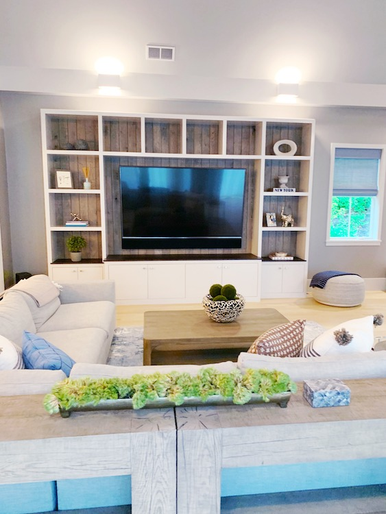 High-end family living room with built in shelves and no clutter.