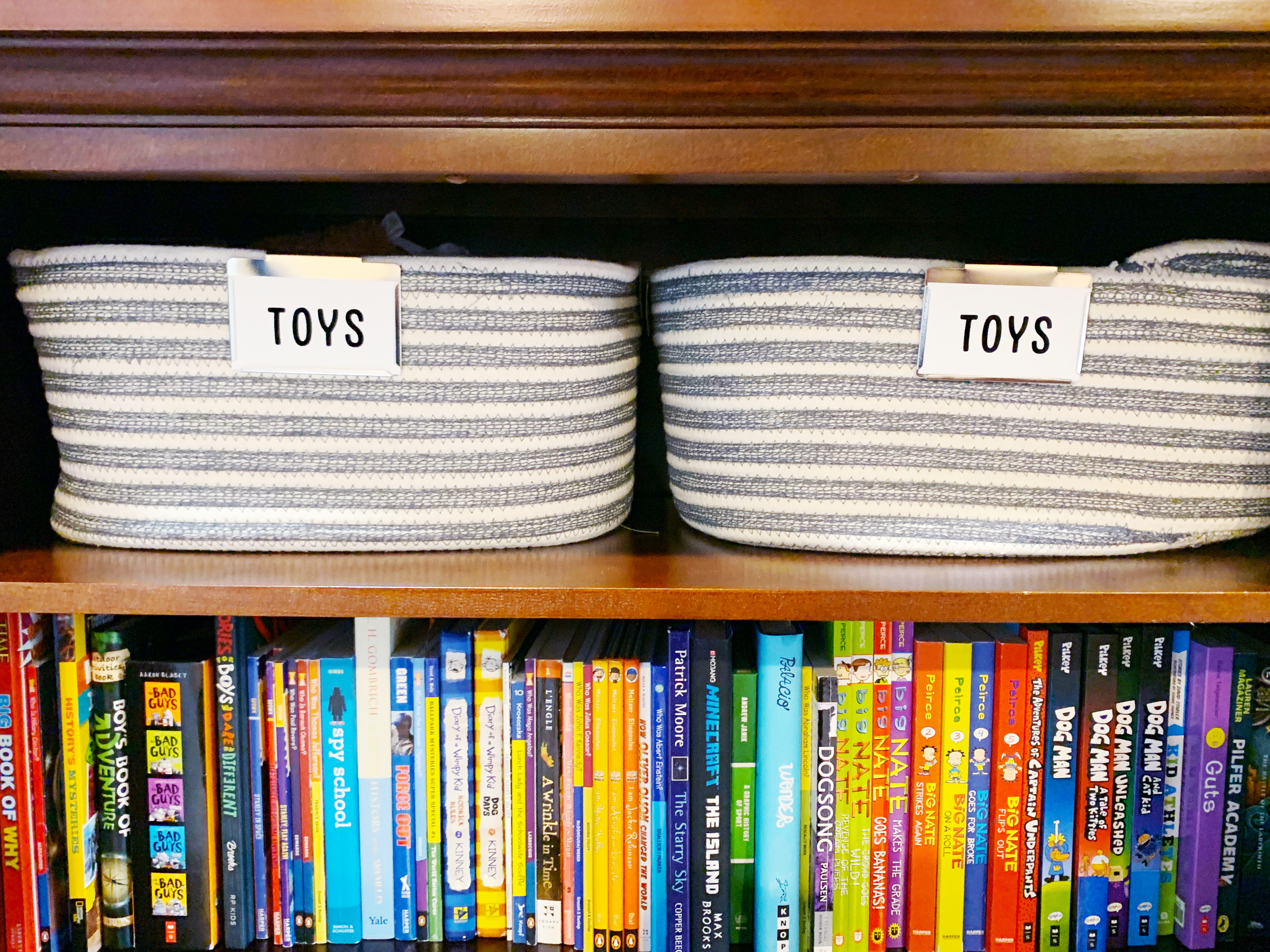 Grey and White Oslo Bins that hold Toys for kids closet
