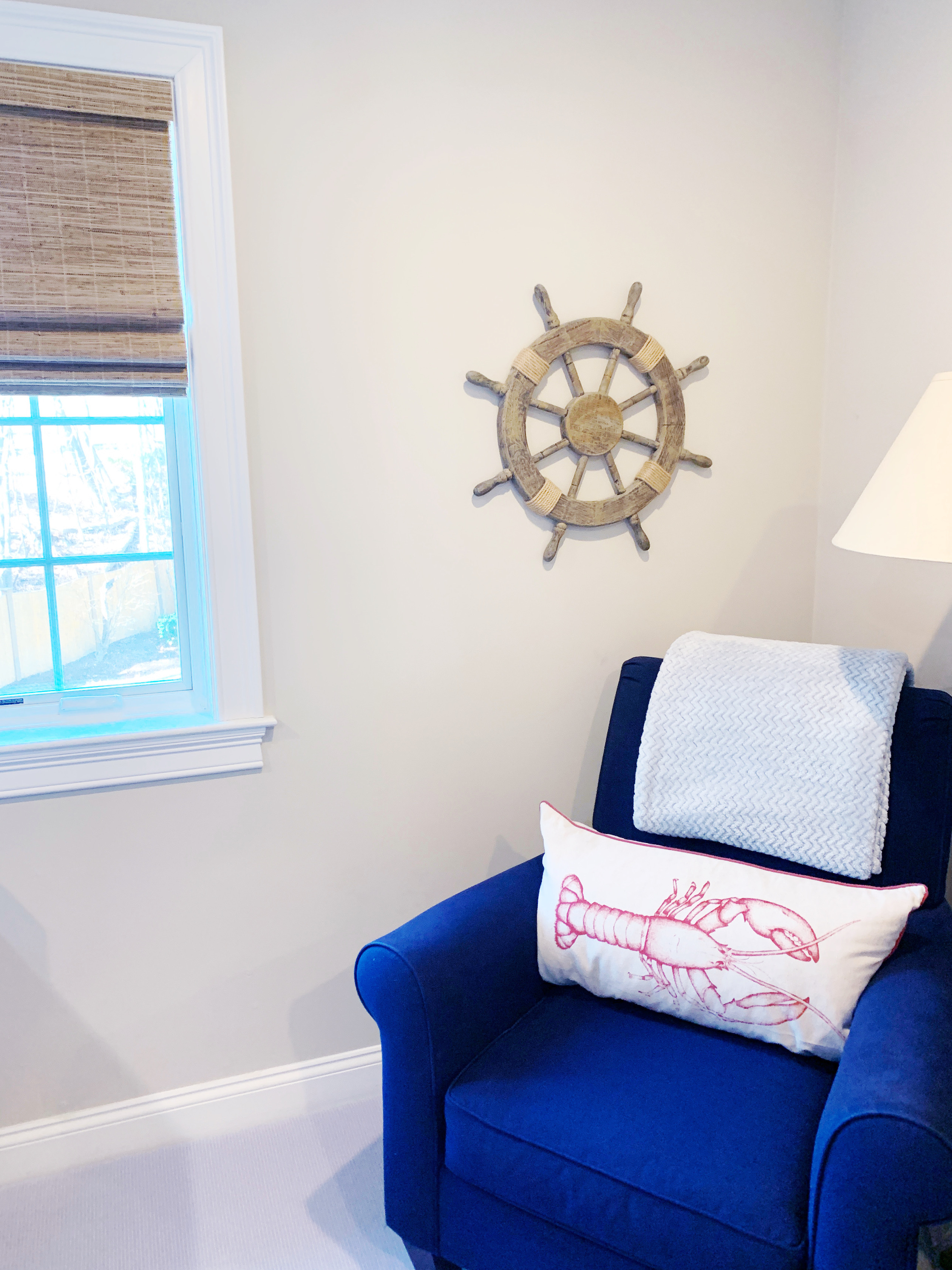 This bedroom is done in a class nautical theme