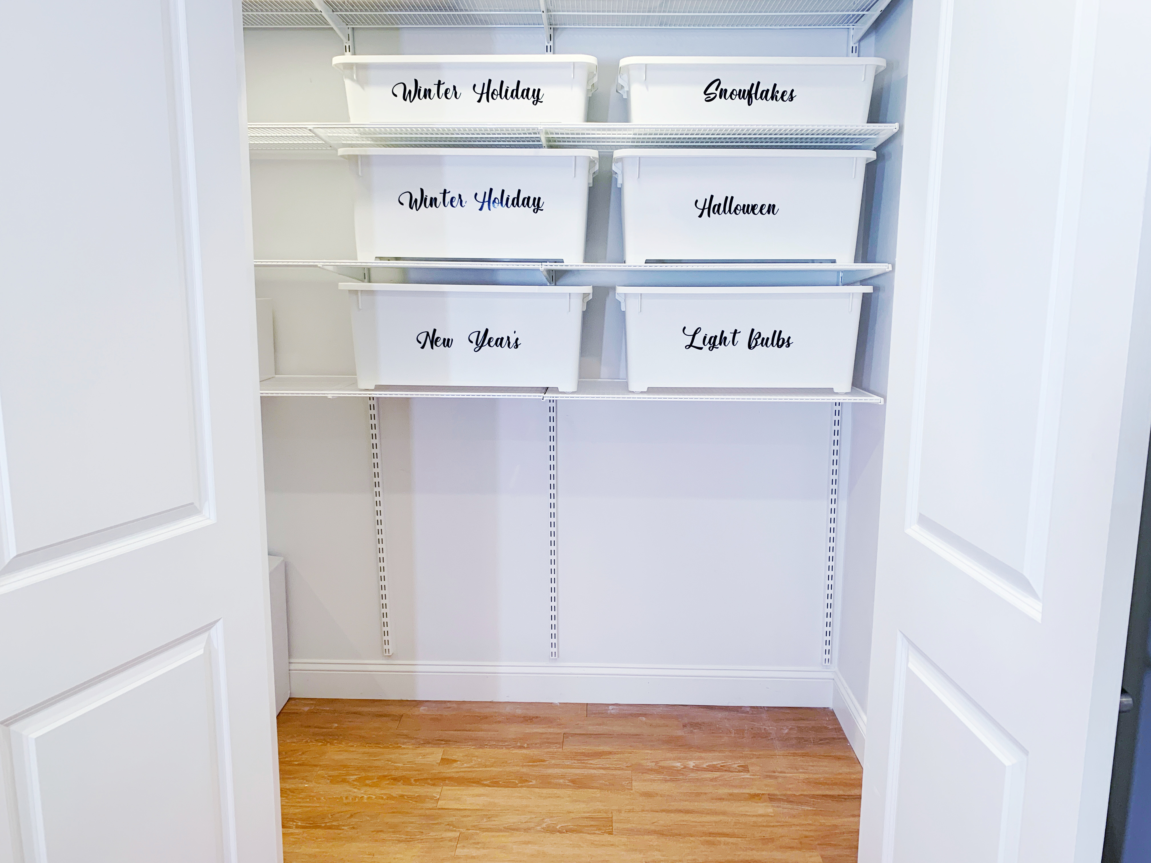 Photo of a white shelving unit inside a storage closet.