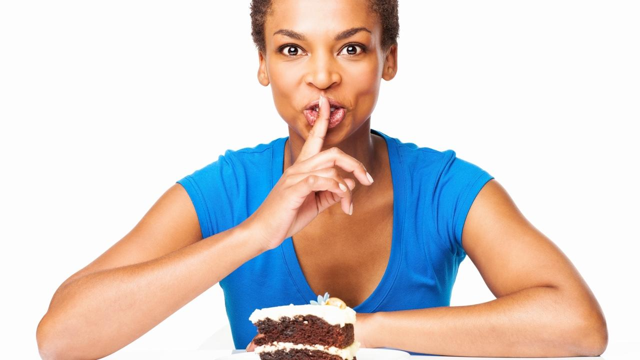 woman without willpower eating sweets