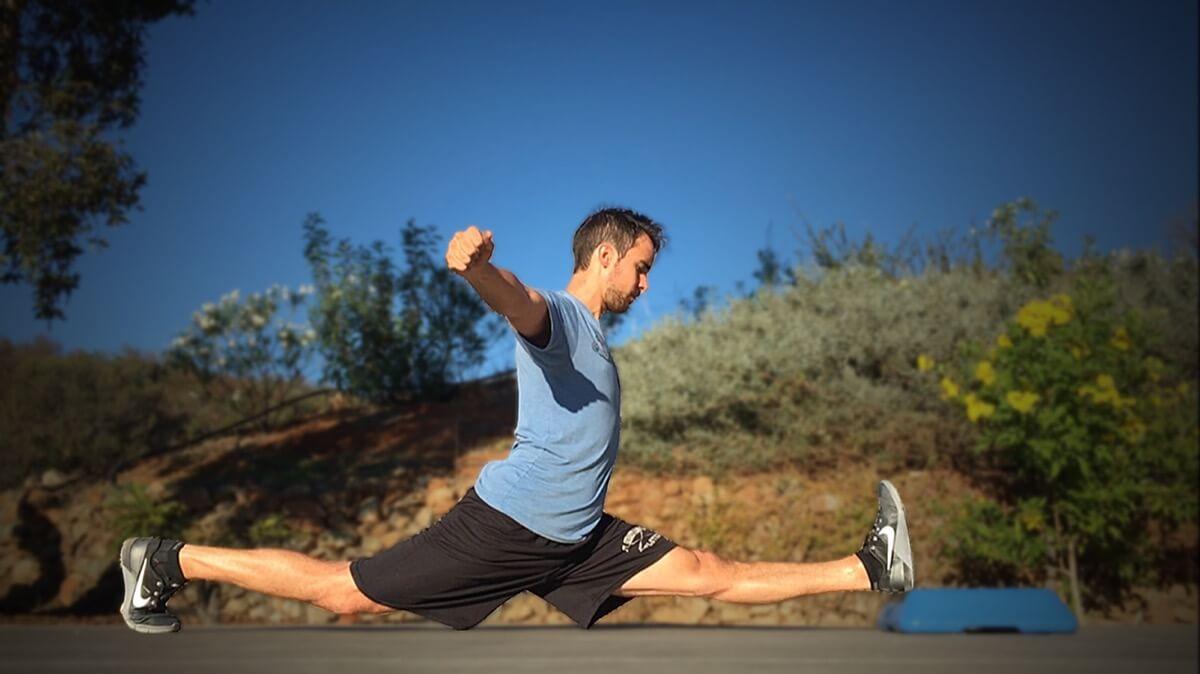 man doing front splits