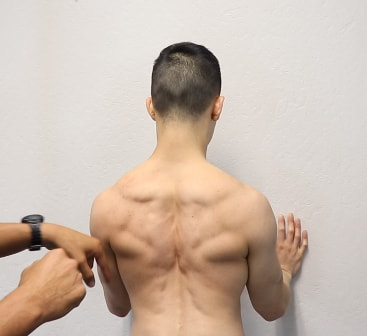 vincent shows scapula positioned back and down during wide pushups at upright health