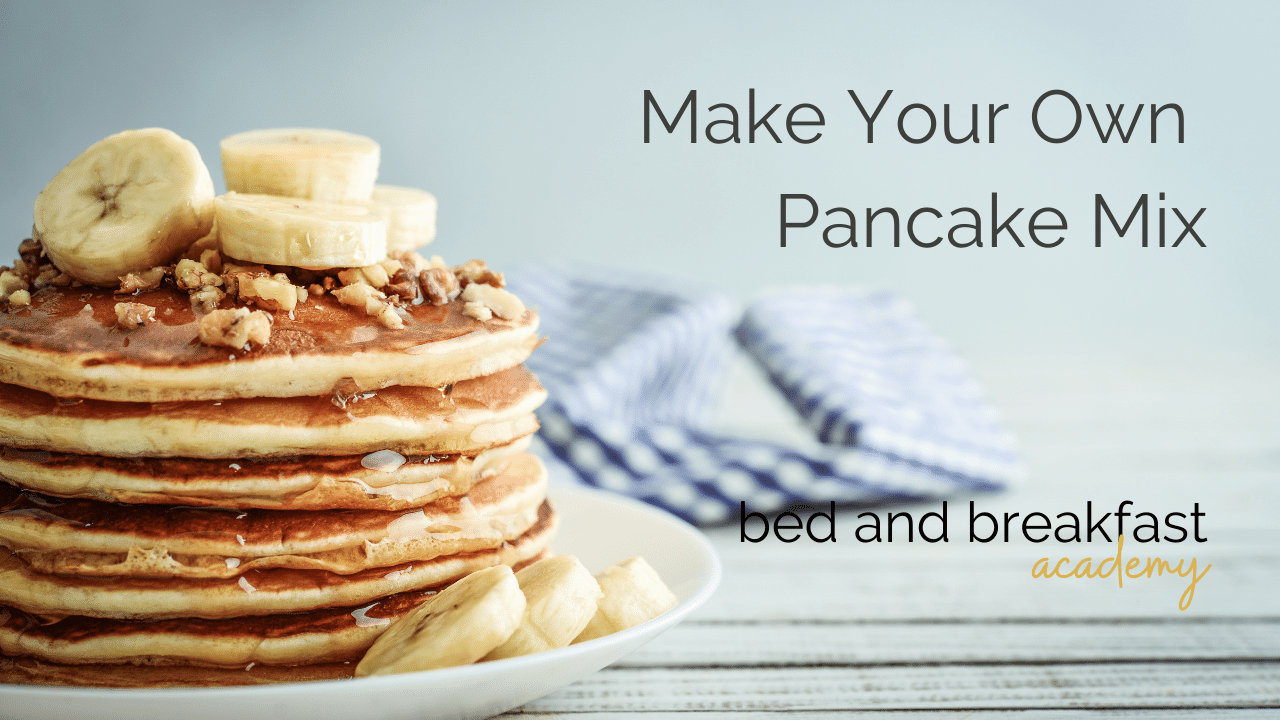 Stack of pancakes topped with a banana. Make your own pancake mix