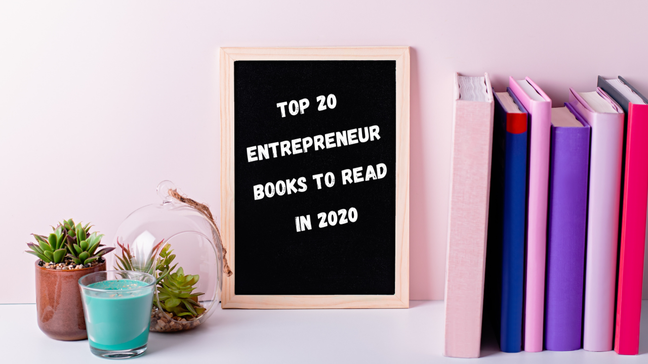 Top 20 Books to Read in 2020 to Help You Think Like an Entrepreneur. Pink and purple books lined up along a shelf with a black board that reads Top 20 Entrepreneur Books to Read in 2020
