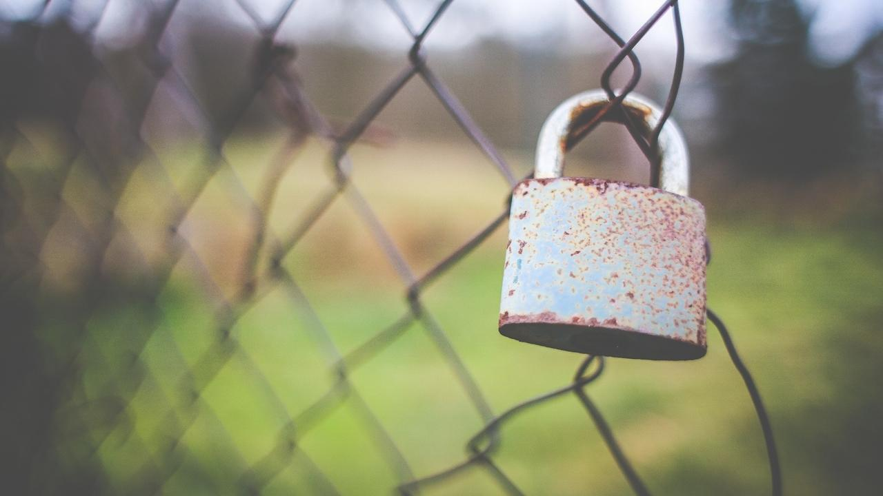 padlock on a chain link fence