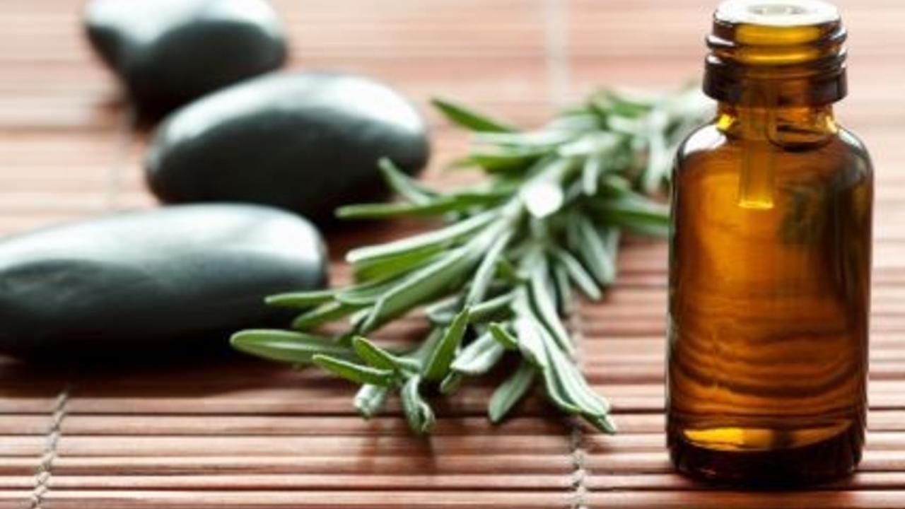 essential oil bottle with rosemary