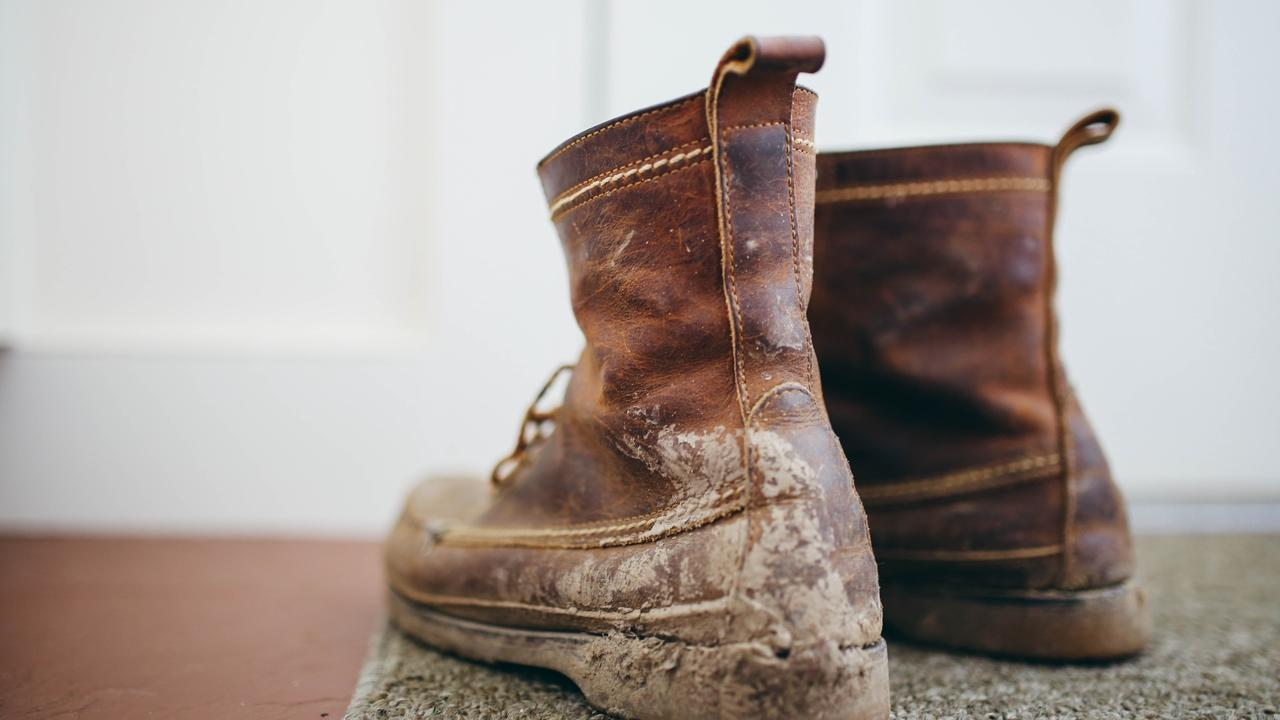 two muddy boots for kicking