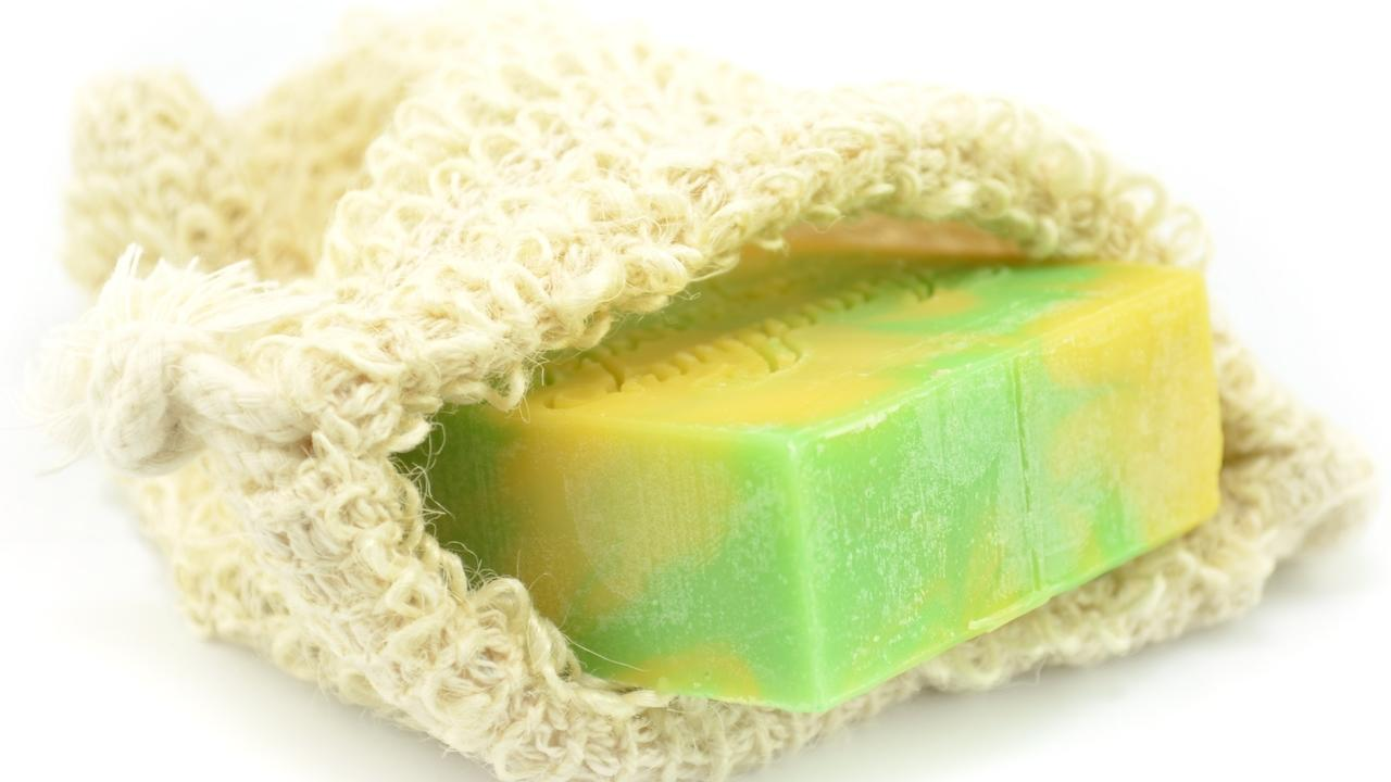bar of soap in a natural fiber soap saver