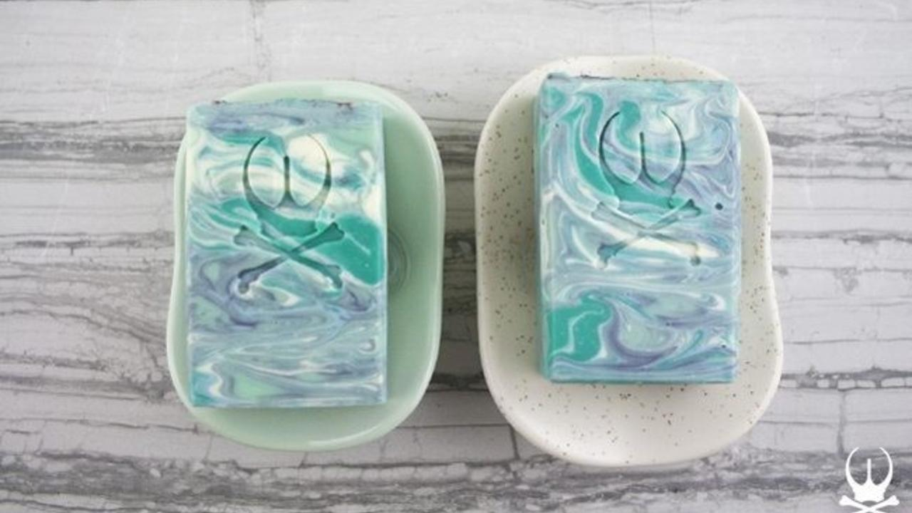 two soaps sitting in soap dishes
