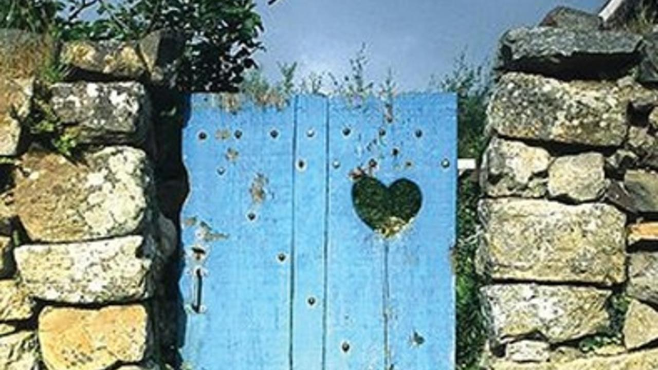 heart carved into gate