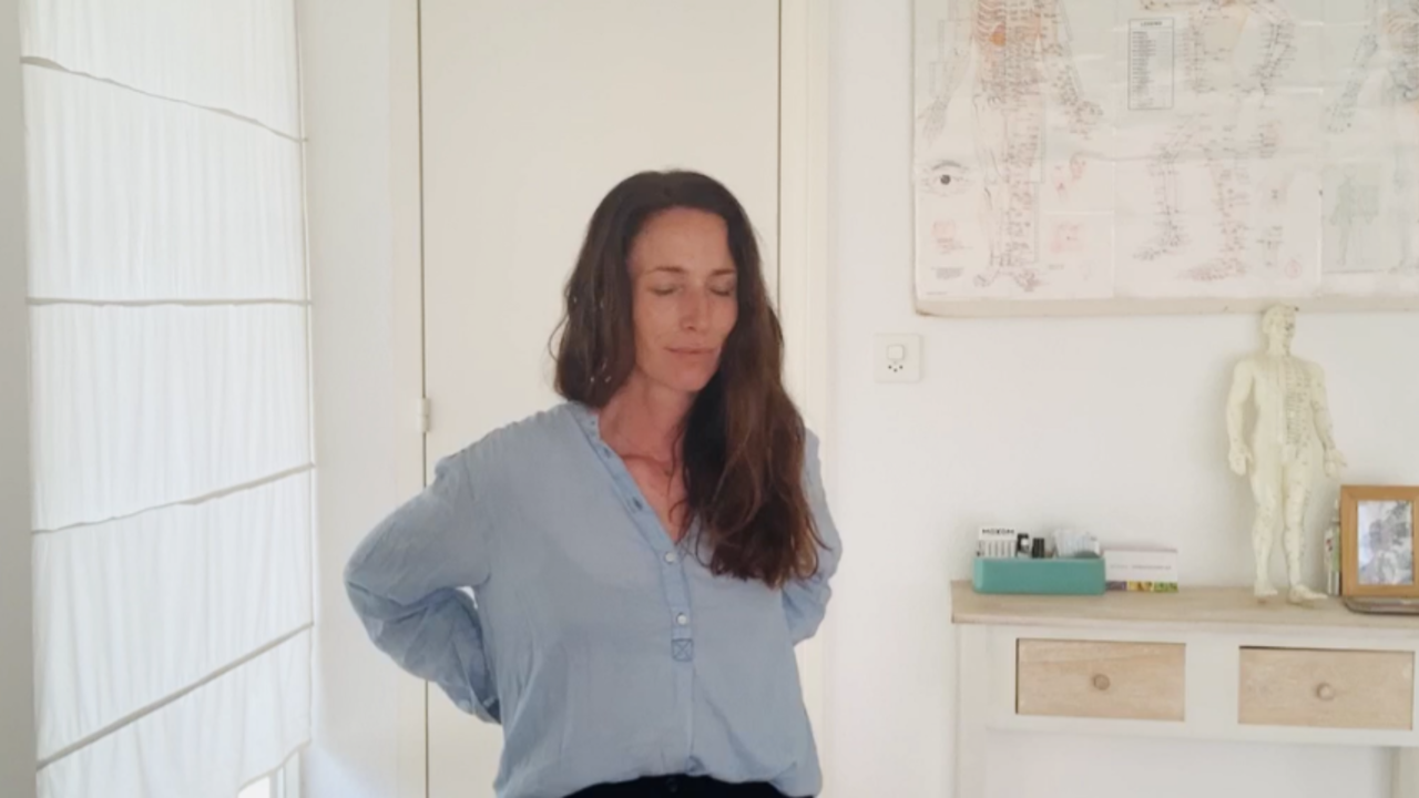 Angela Chambers practicing a Kidney Meridian practice
