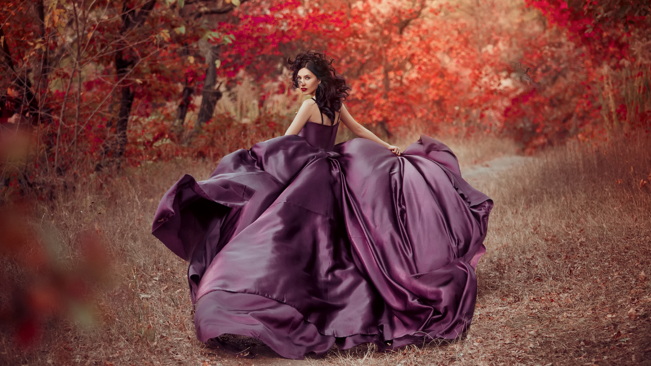 Woman in a purple dress running into the forest seeking her fairytale ending