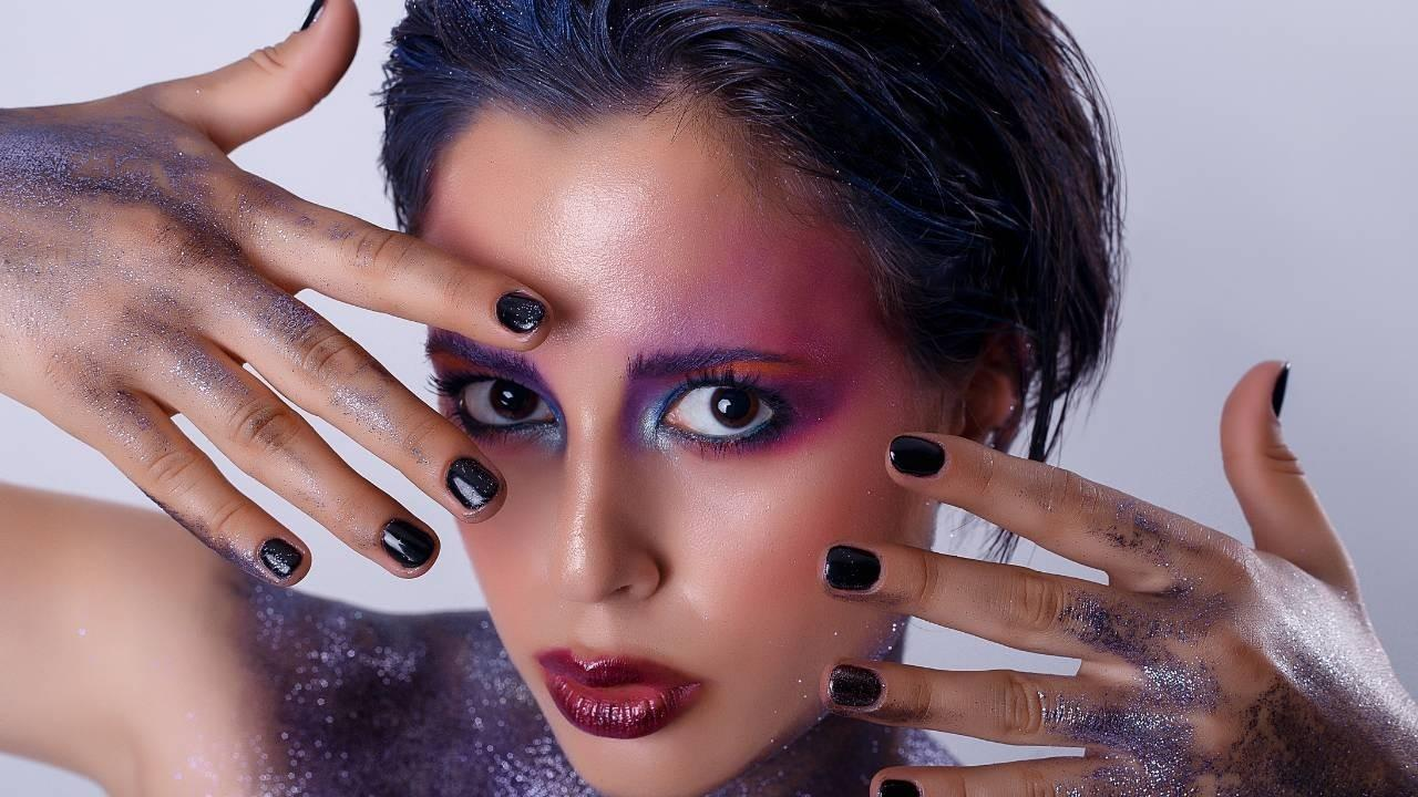 Cosmic girl with hands to face to reveal herself - Get Out Of Your Comfort Zone...and Start Showing Up! - Leanne Juliette