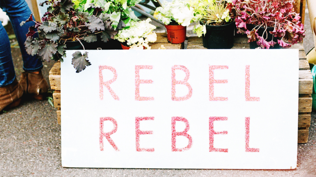 Rebel Rebel board sign - the art of not giving a fuck and being true to yourself especially as a spiritual soul-led entrepreneur and rebelpreneur