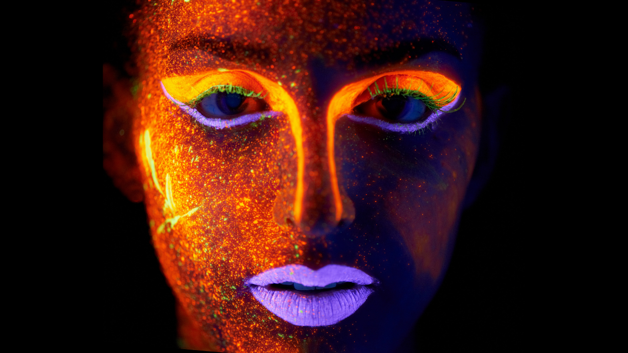 Woman with neon psychedelic face paint - otherworldly - starseed alien and futuristic looking