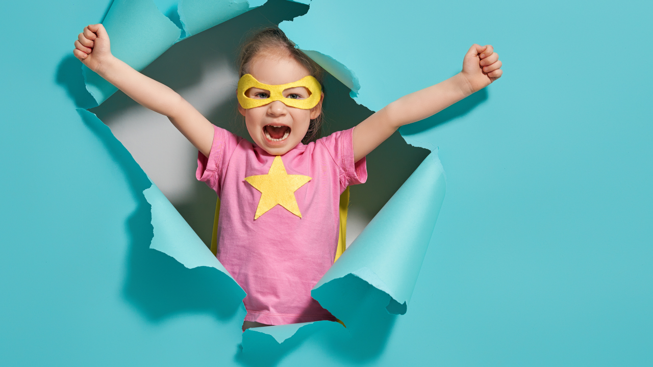 Child in superhero outfit bursting out of the wall - Play In Your Playground First So Your Soul Family Know How To Find You - Leanne Juliette