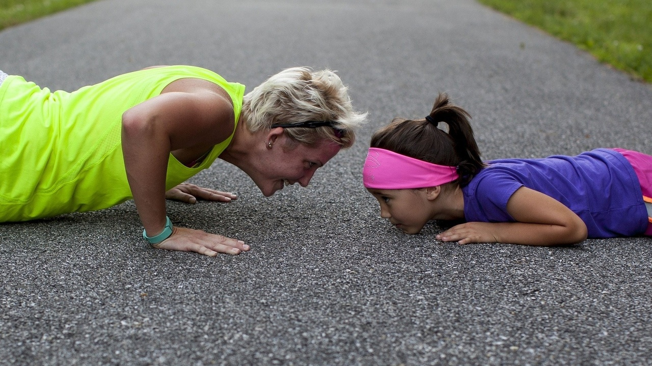 Mom doing pushups with daughter