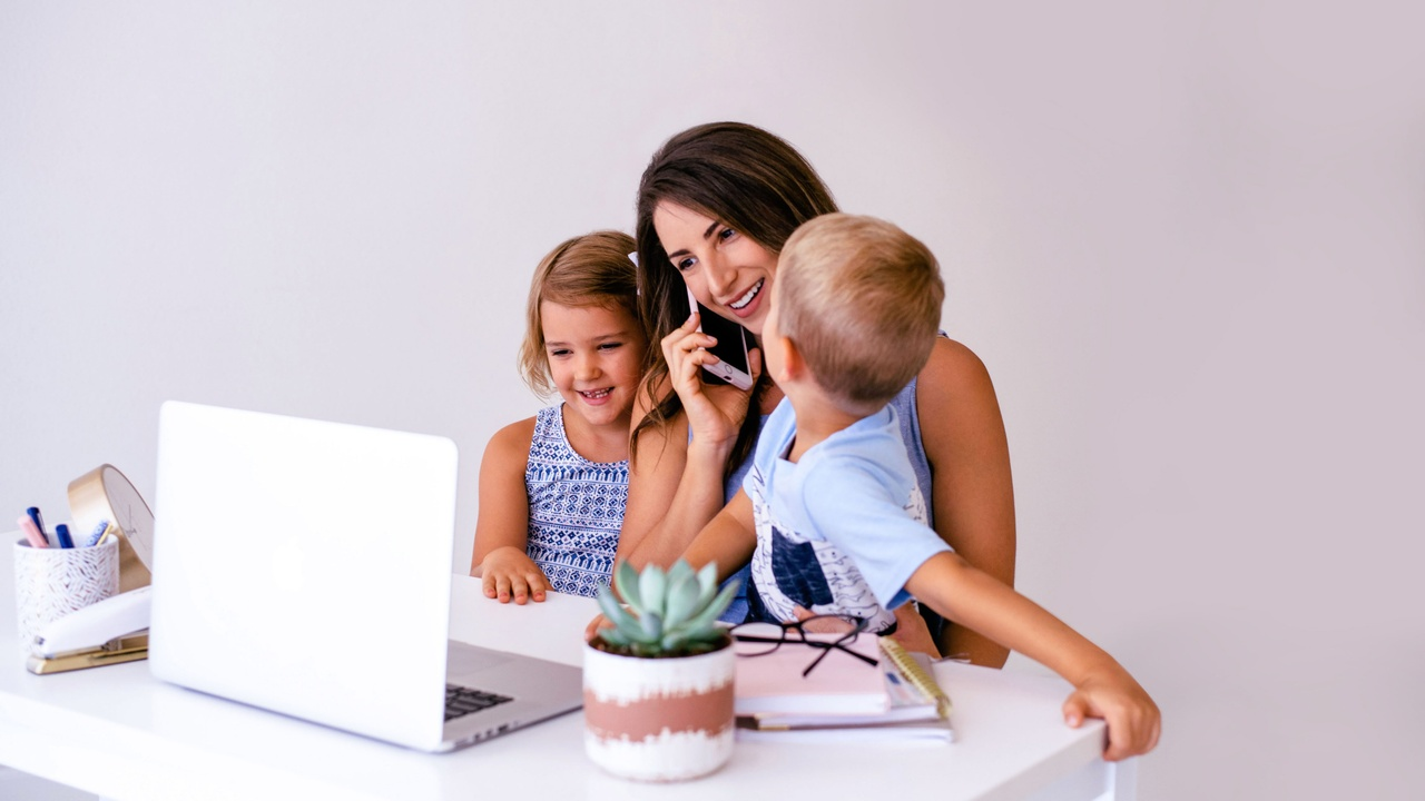 Mom attempting to work from home with her kids