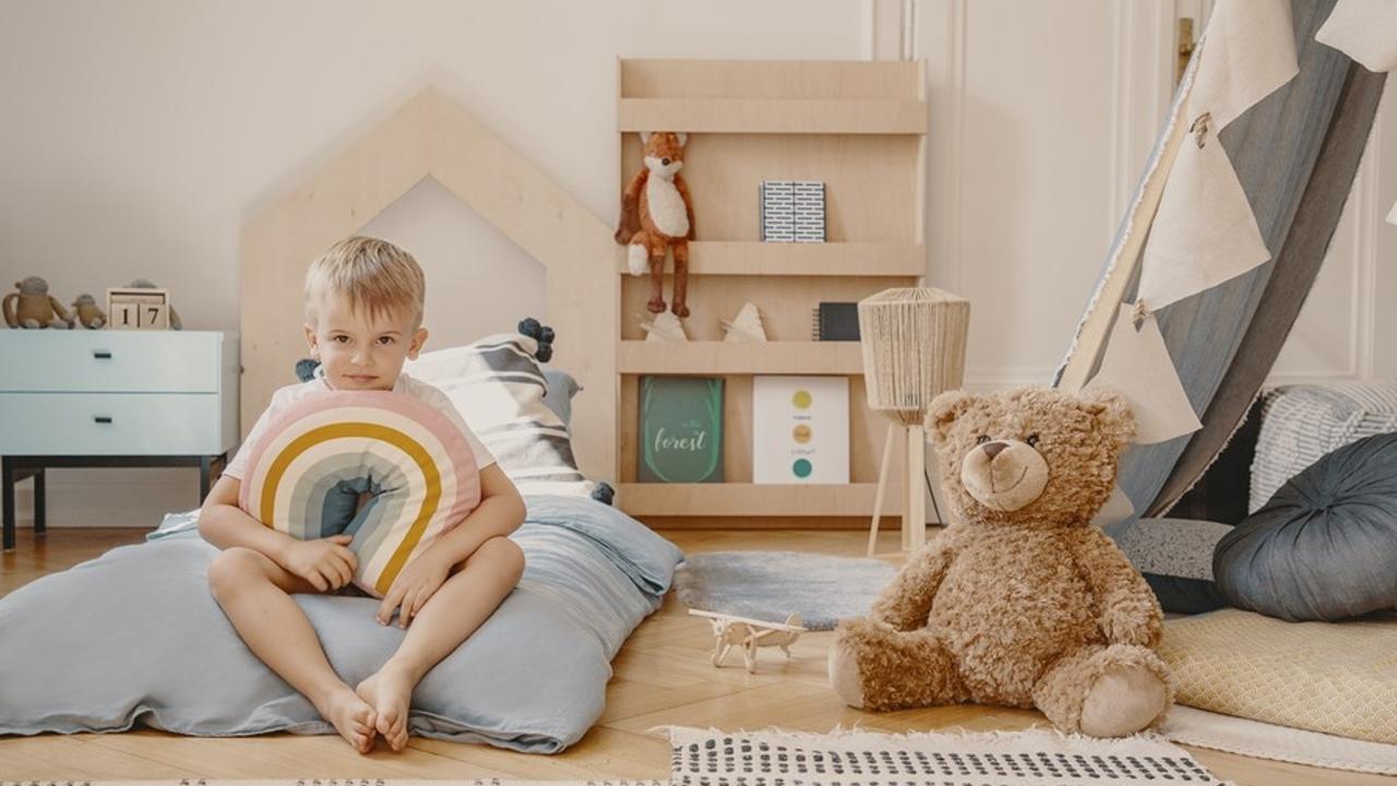 03uha04eqzpw1qg9bvpr bigstock cute boy sitting on bed in sca 285950305