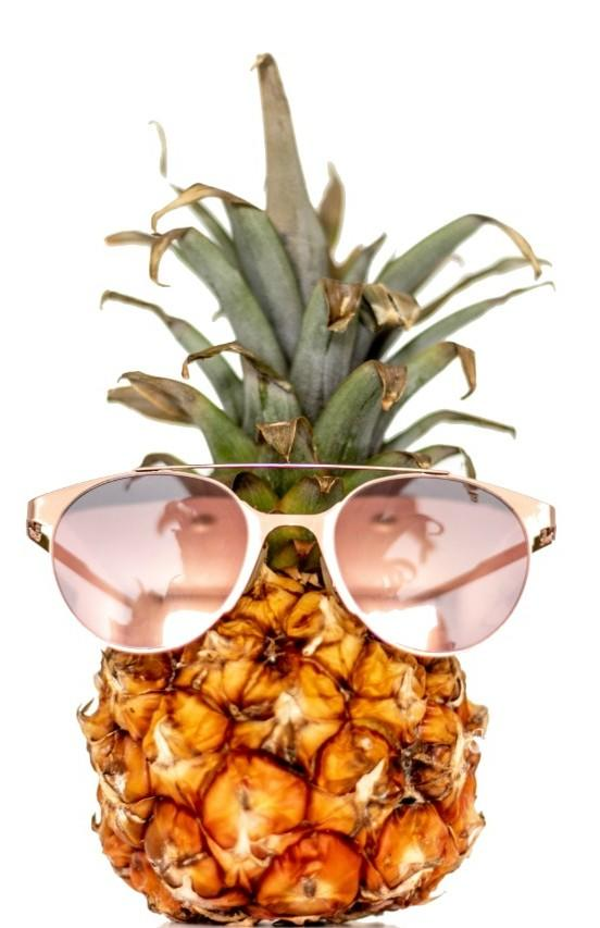 pineapple in pink sunglasses