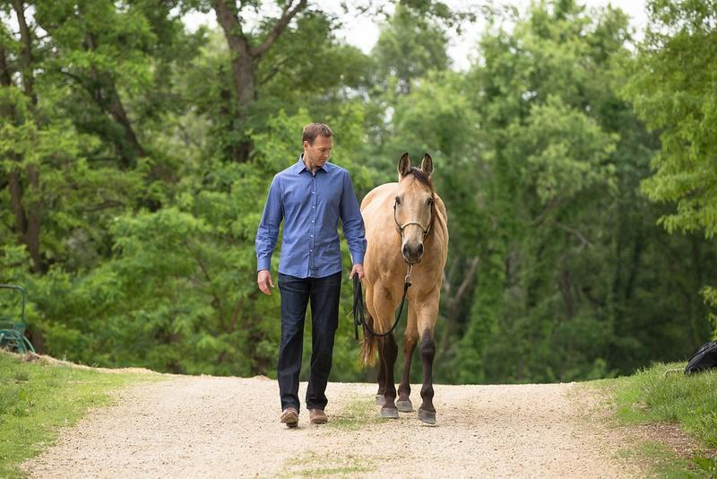 Horse Empowered programs. Shawn Carlin walking with his horse