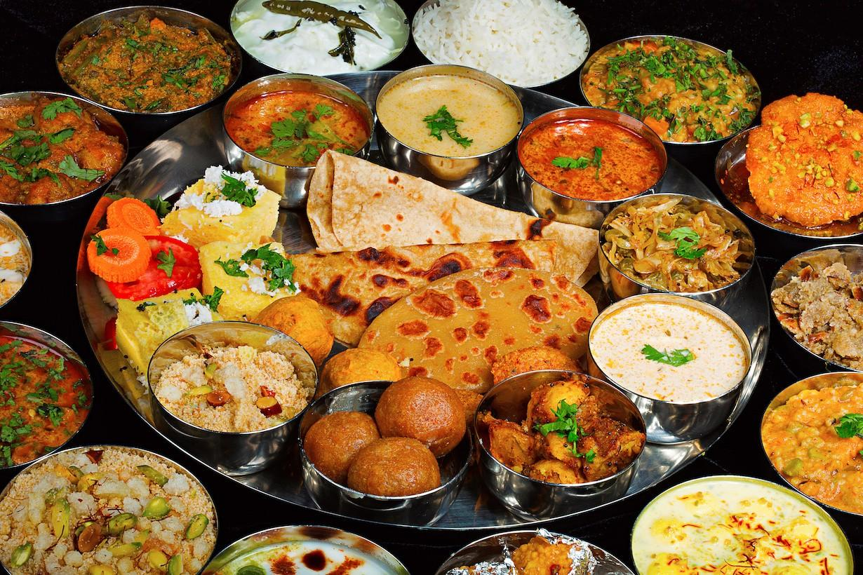 A spread of vegan Indian recipes of dal, dosa, naan, curry, chutney
