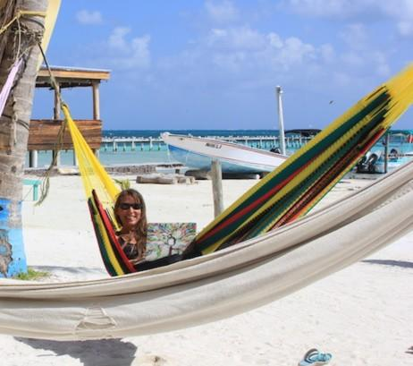 digital nomad job woman in hammock at the beach with computer