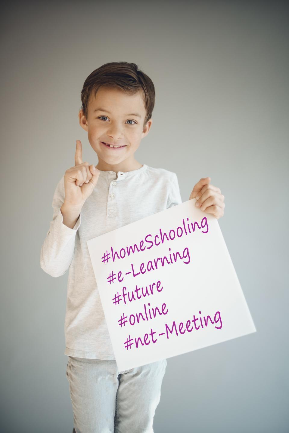 Home-schooling child with e-learning and online business sign.