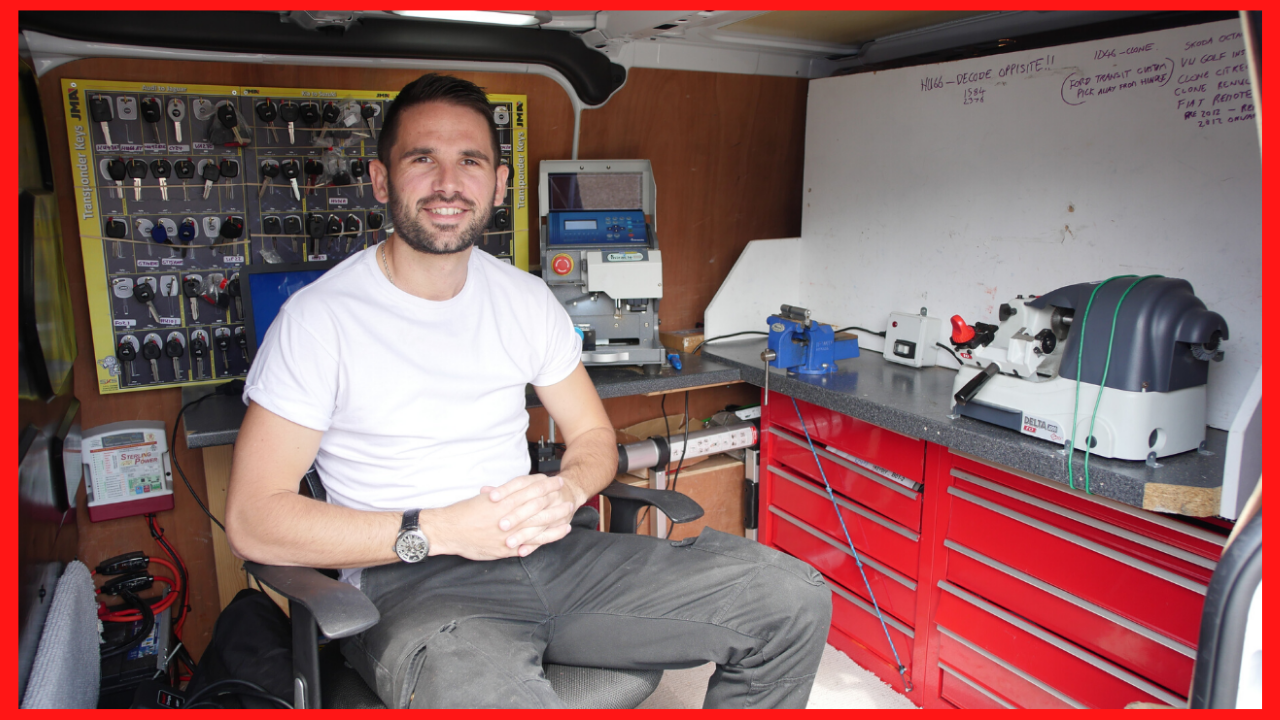 an online locksmith trainer sitting in a locksmith van